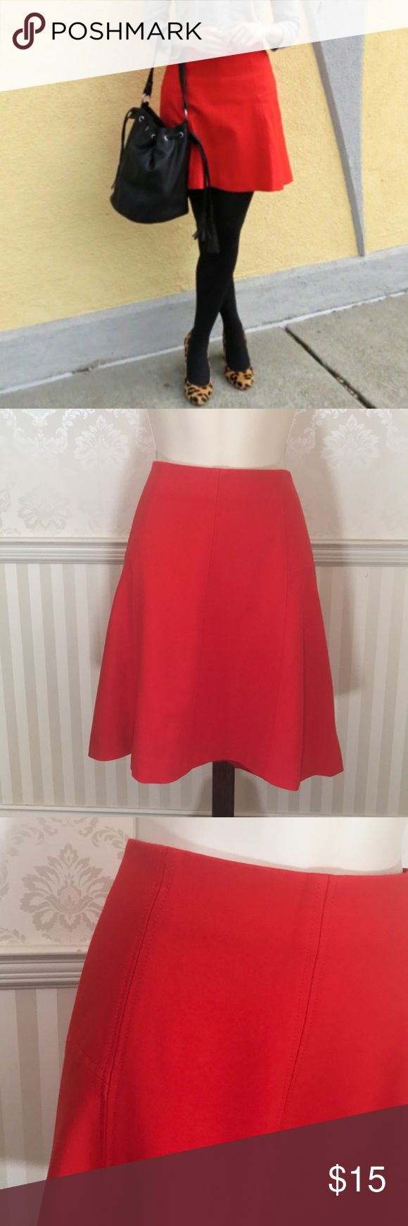 "NWOT Ann Taylor LOFT Red Ponte Flared Skirt NWOT Ann Taylor LOFT flared skirt in absolutely perfect condition.  Vibrant bright red color.  This skirt is made with a blend of soft, resilient ponte & rayon for a soft draping effect & a smooth, crisp look.  Perfectly placed seams create a flattering & feminine silhouette.  Concealed back zipper.  Fully lined.  Length is about 19,"" waist is approximately 34."" 67% rayon, 28% nylon, 5% spandex; lining is 100% polyester.  Size12. LOFT Skirts"