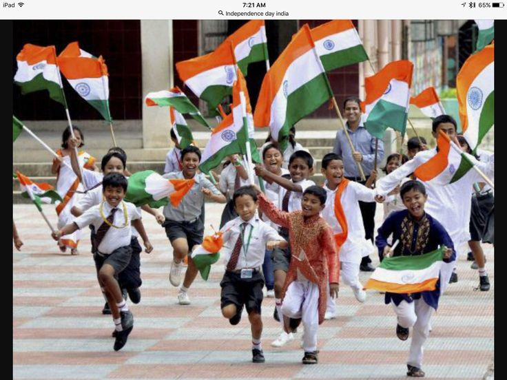 School children celebrating Indian Independence Day with the Indian flag.