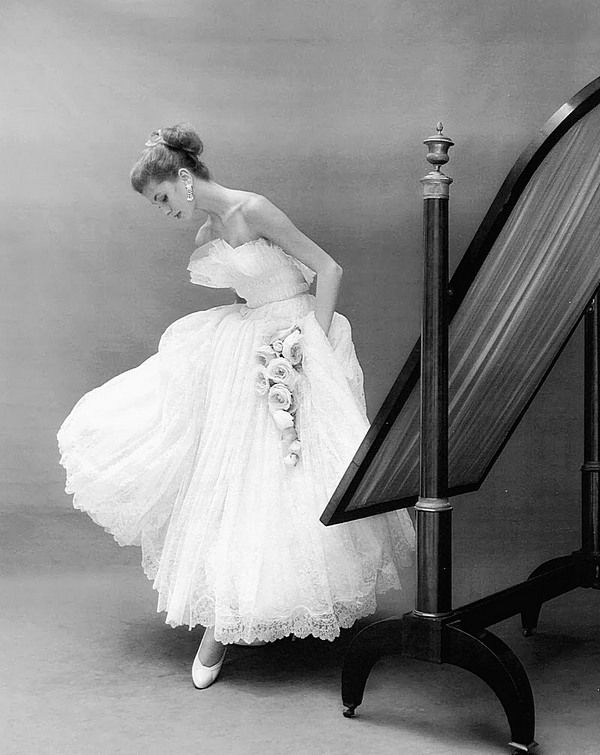 1953. ELLE. Model Suzy Parker in a dress by Jacques Heim. Photo by Georges Dambier (B1925 - D2011)