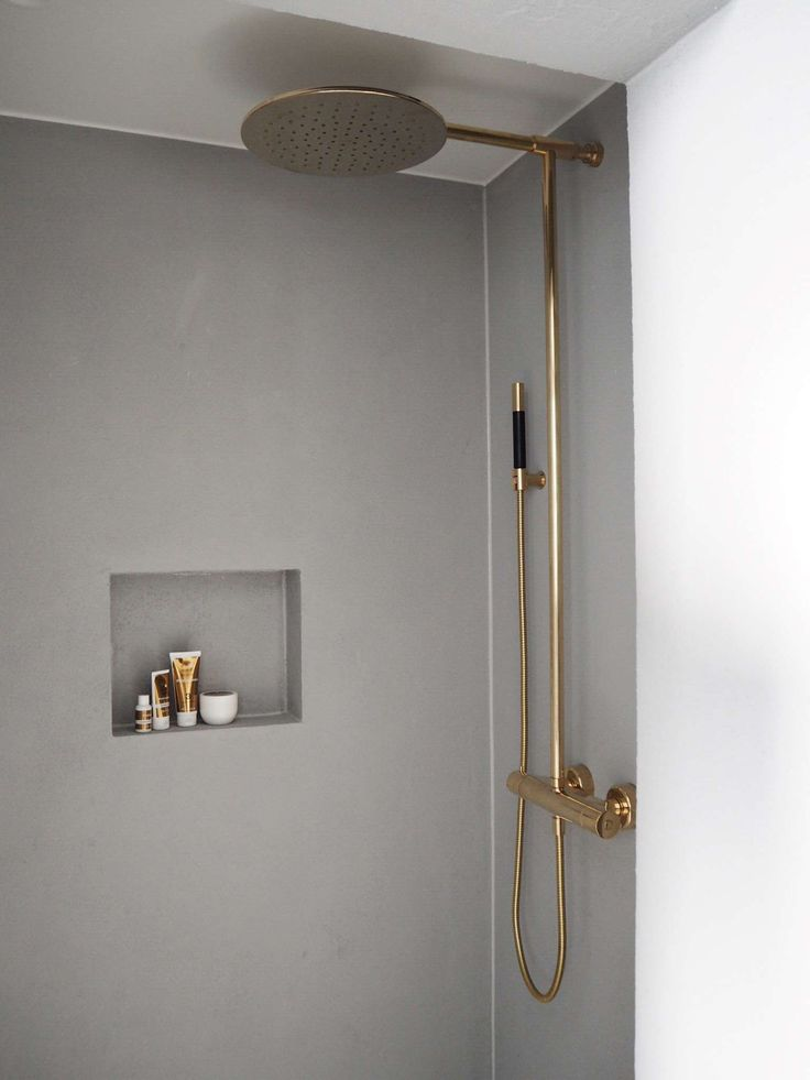 brass fitting in grey bathroom