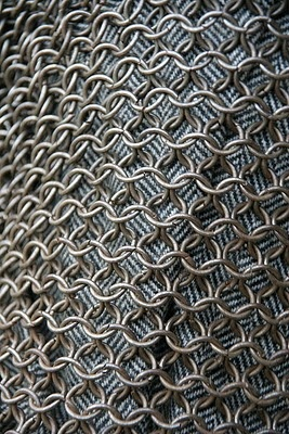 Roman chain mail I see how to knit this K 1 row of fiber of choice K 1 row with rings only Repeat