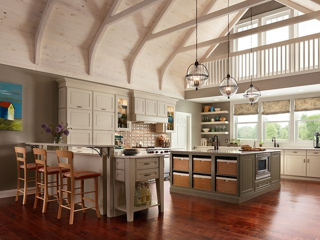 large eat in kitchen with cathedral ceilings and square island