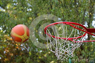 Throw the ball to the basketball hoop red.