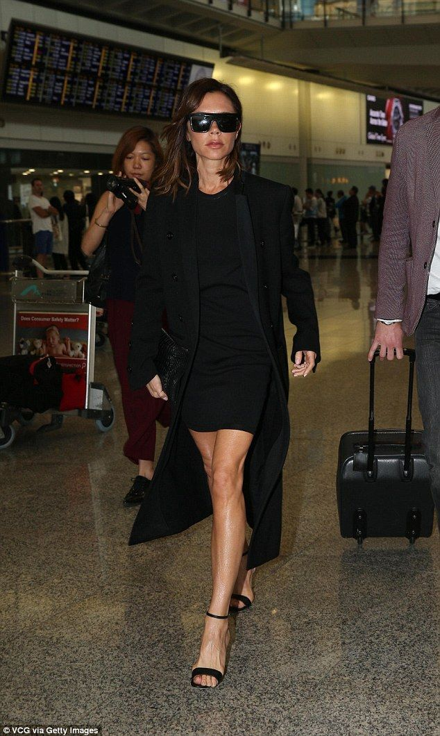 Simple touches: The style savvy star wore a pair of strappy black heels and her favourite designer shades