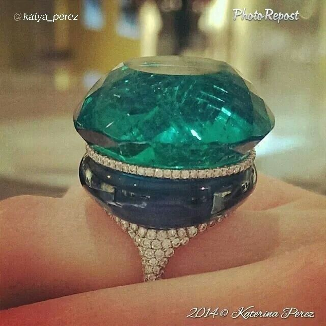 Emerald, May's birthstone, sits proudly atop an aquamarine and diamond ring. Statement Jewel by G International
