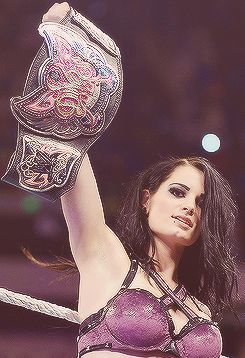 WWE Diva Paige. - Damn it, I wish they would get rid of that Divas belt and bring back the Women's Championship belt. I can't take the Divas belt seriously at all.