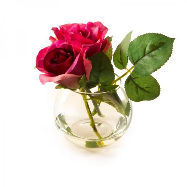 Dark pink roses in a small fishbowl in still water. Height 14cm. €13.50