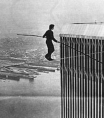 Vintage Summer 1974, Phillippe Petit progresses in his high-wire walk between the Twin Trade Towers, NYC, www.RevWill.com