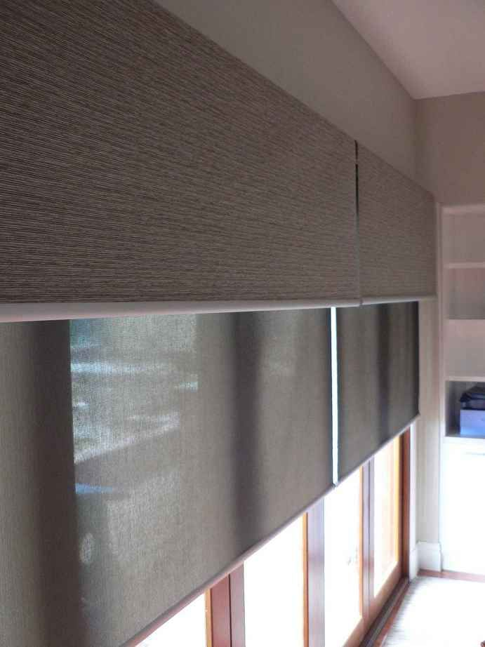 Fixed fabric pelmet with battery operated roller blinds behind