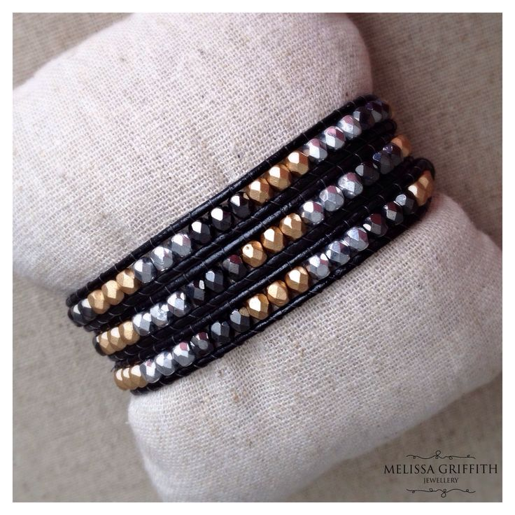 Mixed Metal Czech Glass Triple Wrap Bracelet (MGB100) $46.00  This iridescent wrap bracelet features 4mm black, gold, and silver toned fire polished Czech glass beads individually strung between black genuine leather cord. Button closure with two loops for adjustability. Fits a 6-7 inch wrist.