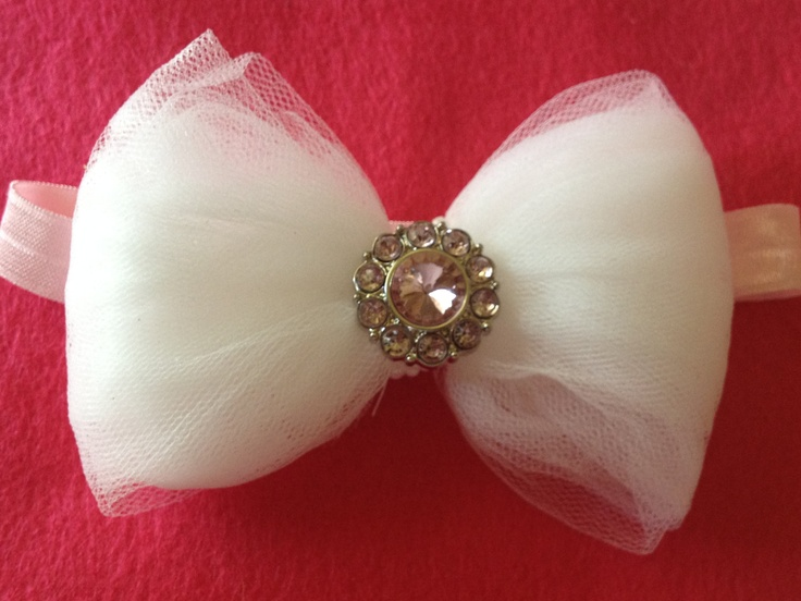 White Tulle Shabby Chic Bow with Rhinestone on a pink Headband. $8.00, via Etsy.