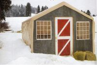 Goat barn made with pallets and a cheap carport!