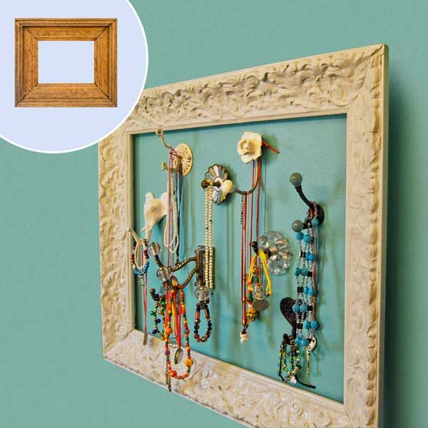 Turn a Picture Frame into a Jewelry Display: Remove the backing and glass from a secondhand frame, spray-paint it, and hang it to surround mismatched wall hooks. | Photo: Courtesy of Kara Kersten; (inset) iStock Photo