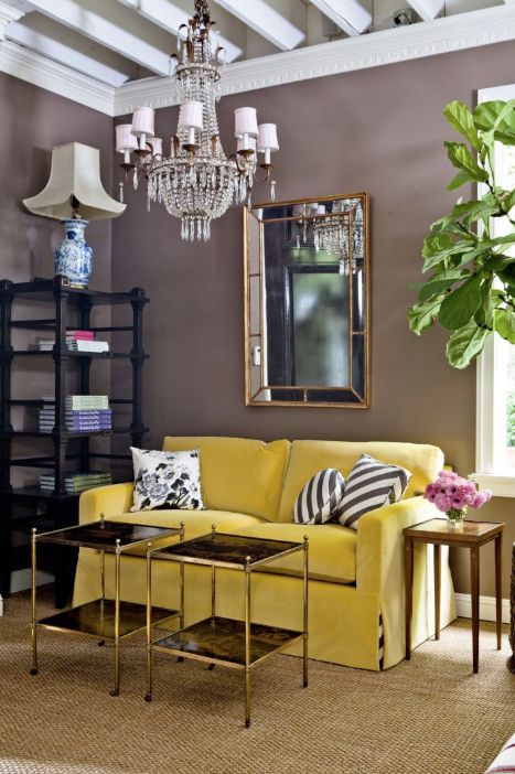Kristen Buckingham's showroom. How much do you love that little canary yellow velvet sofa popping against those brown walls? Sisal rug adds lightness and texture,