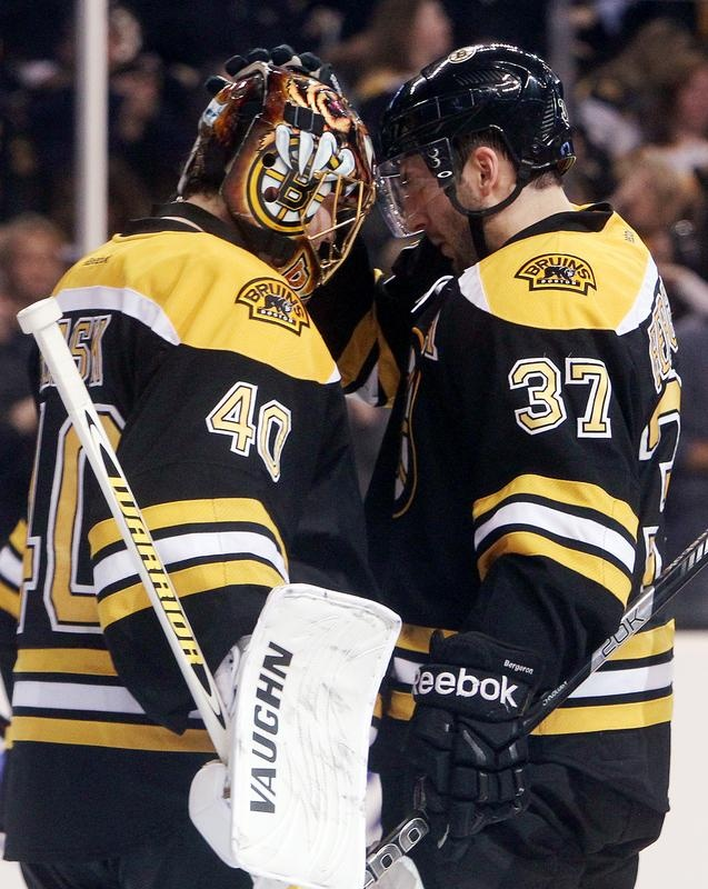 Bruins 3, Rangers 1 - Tuukka Rask (40) and Patrice Bergeron (37) tap helmets to celebrate their win against the Rangers at the TD Garden during the season opener, Saturday.