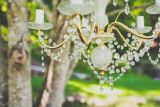 Vintage chandelier outdoor wedding styling   Owl + Pussycat Events