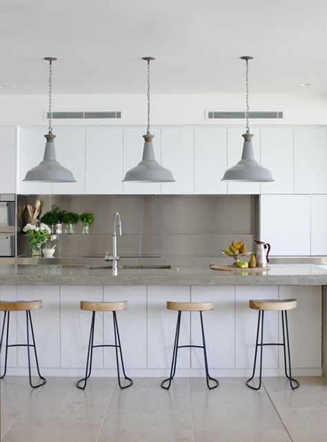 Kitchen Dreams. Minimal white cabinets with industrial lighting, stools, and faucet. Interior Designer Justine Hugh-Jones.