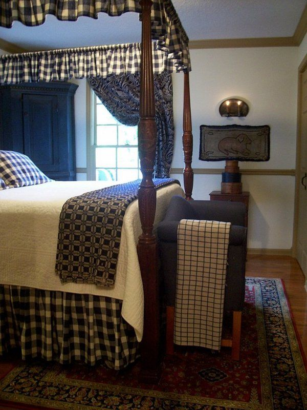 colonial bedroom dressed up in blue high bed