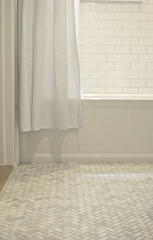 White subway tile walls and marble herringbone floors for Small bathroom herringbone tile