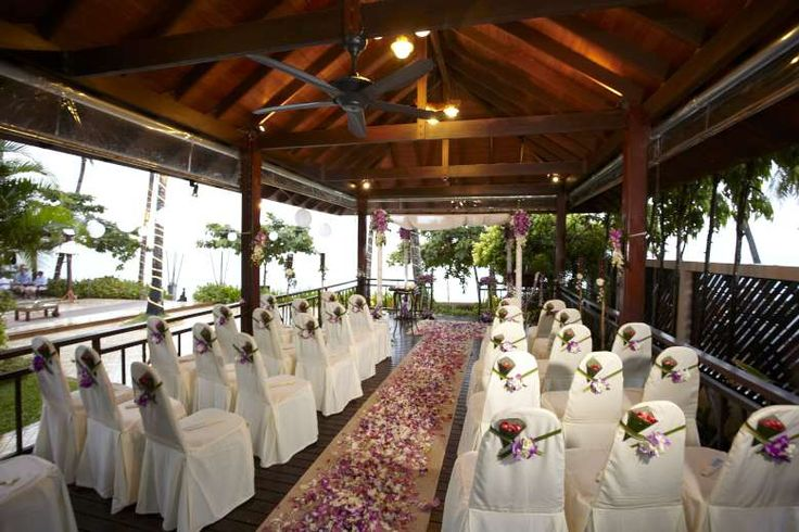 An aisle of purple orchid petals brightens even a rainy wedding day