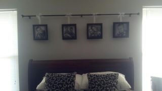 Pictures hung from a curtain rod over the bed: Diy, Covers Window