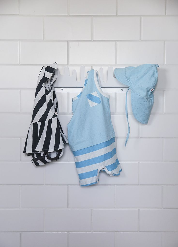 The summer baby's wardrobe is full of light, breathable beachwear. Keep your baby in the shade as their sensitive skin won't yet be able to withstand the rays of the sun or suncream.