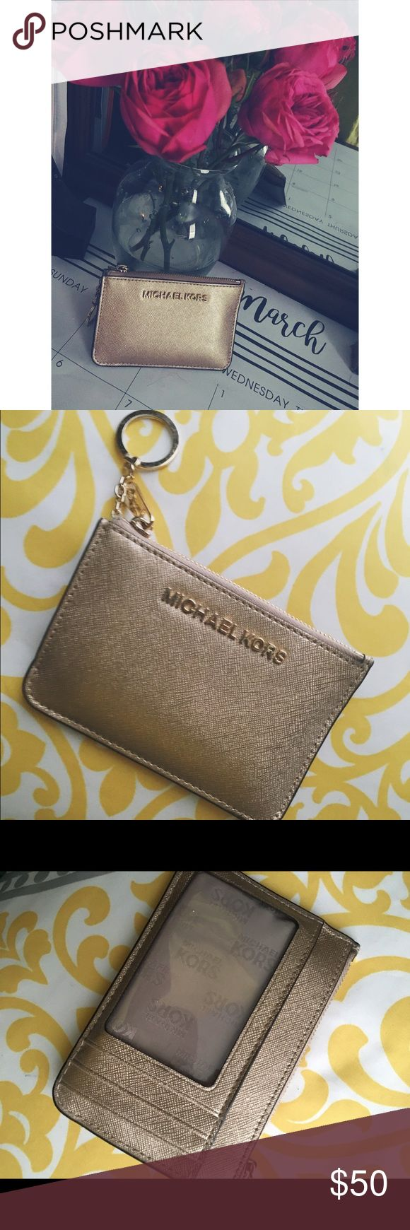 Michael Kors Coin Purse Small wallet with key ring. ID and 3 card slot on the front with a bill holder and 2 compartment zipper pouch. Pale gold with gold hardware. Very lightly used, minimal scratches on the metal || accepting $40 through  venⓂ️o || KORS Michael Kors Accessories Key & Card Holders