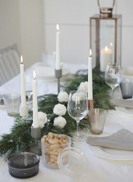 Christmas table setting... Fir branches and carnation flowers.