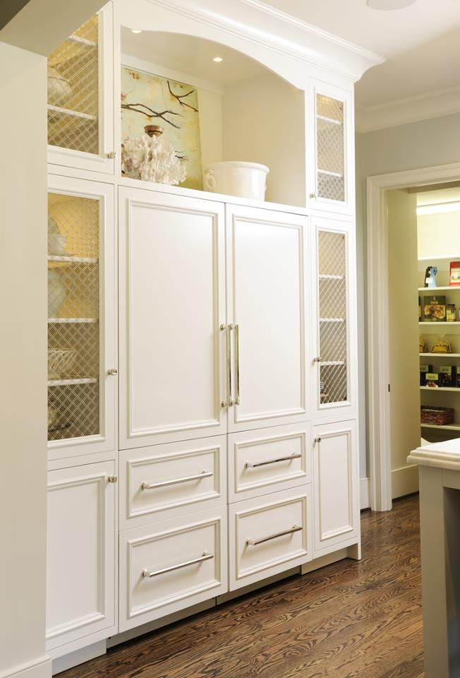 "A close-up of Caroline Weigel & Heather Looney's kitchen designs, with Sub-Zero and Wolf's flush inset 27"" wide all refrigerator, 27"" all freezer custom panel towers."