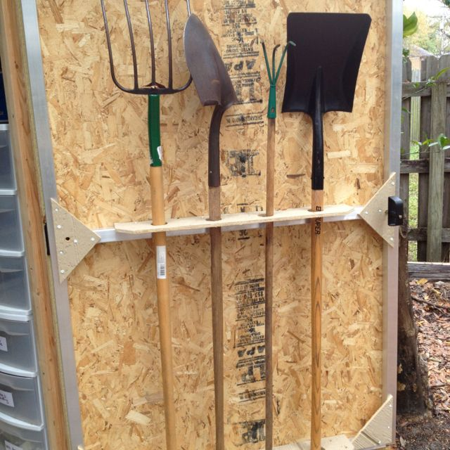 Shed door doubles as shovel storage sheds and organizing for Garden tool storage ideas