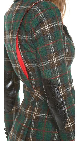 Smythe hunting jacket. I think I've got a vintage shirt dress pattern with this sort of detail on the back.