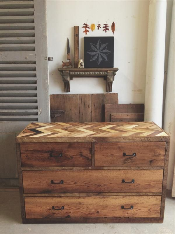 now here is a vintage wooden pallet chest with some antique pattern on the top while the drawers are having metallic handles instead of same typical knobs antique unique pallet ideas