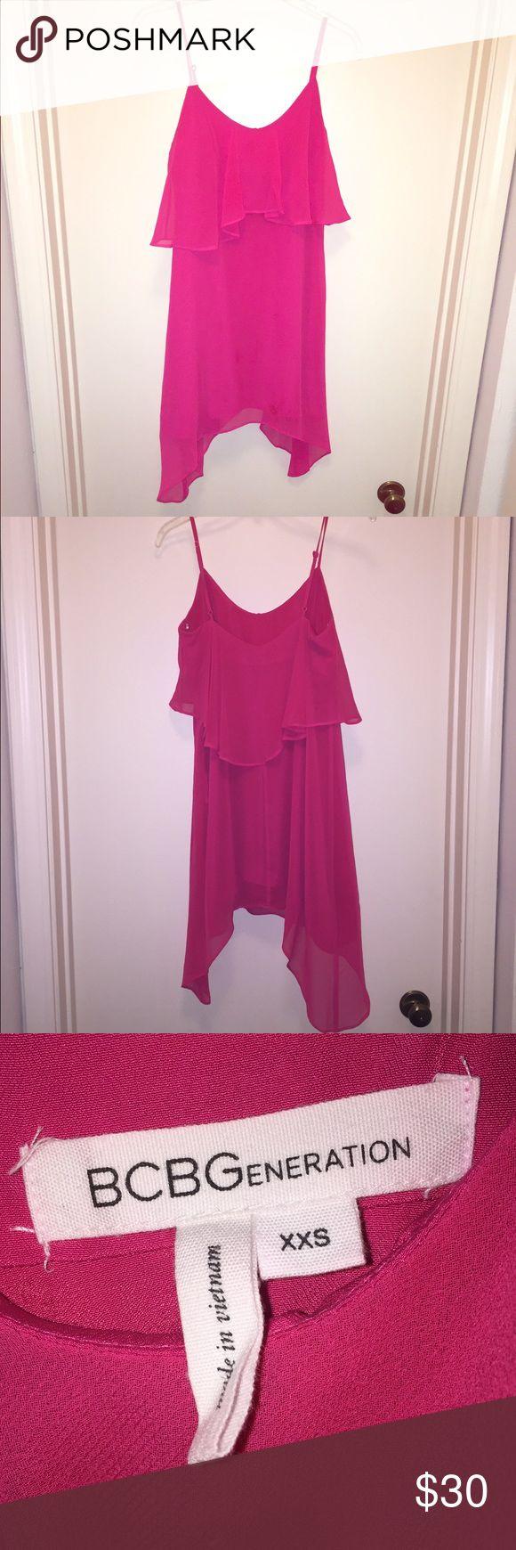 BCBGeneration hot pink ruffle dress XXS Hot pink ruffle dress with asymmetrical hem from BCBGeneration. Size XXS. Adjustable straps BCBGeneration Dresses Asymmetrical