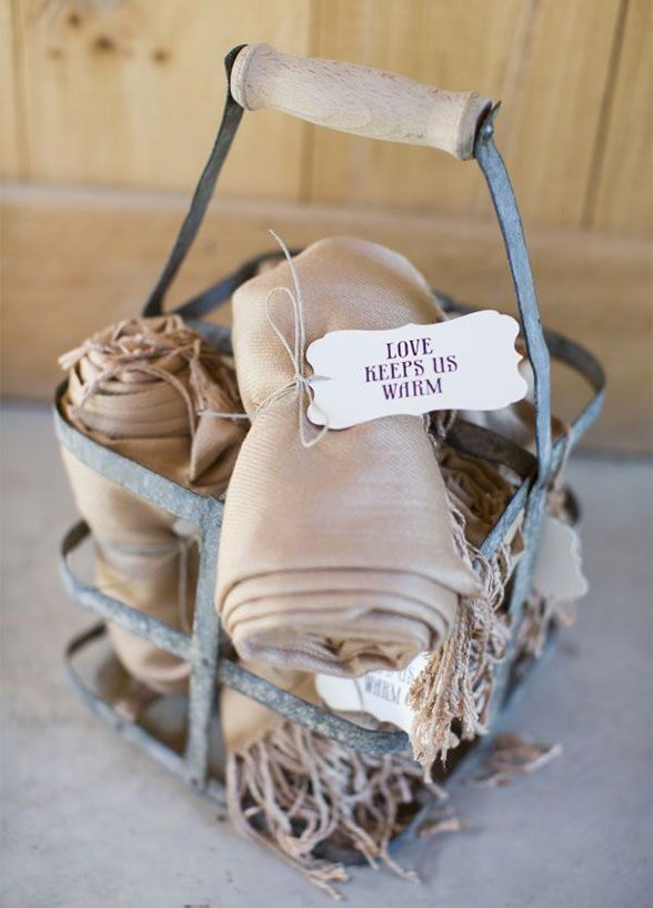 An adorable knit doubles as a way for guests to keep warm at your wedding and as a keepsake that will have them remembering your special day for years to come.