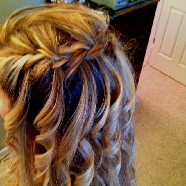 I did a waterfall braid on my daughters head tonight, then curled each waterfall.
