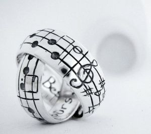 music wedding bands---this would be awesome if you could pick the notes on the ring and have it be a melody that's special to the couple