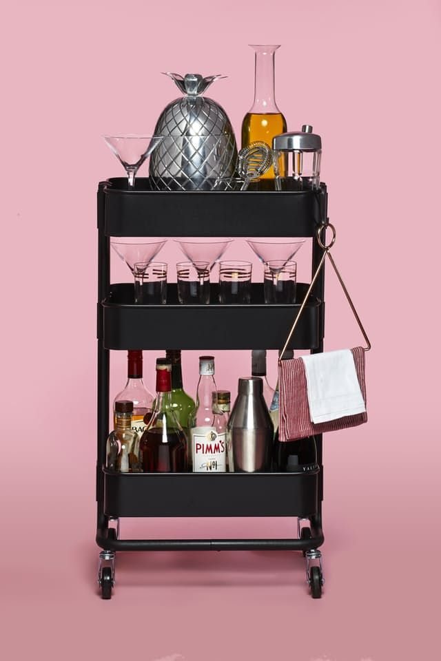 A bar cart should never be a luxury — we'll drink to that! But wait, where are you going to fit it? The crowd-favorite, small-scale RÅSKOG cart from IKEA comes to the rescue again. It's the perfect size for any space, whether that's a tiny apartment or not-so-noticeable nook in the corner of your dining room.