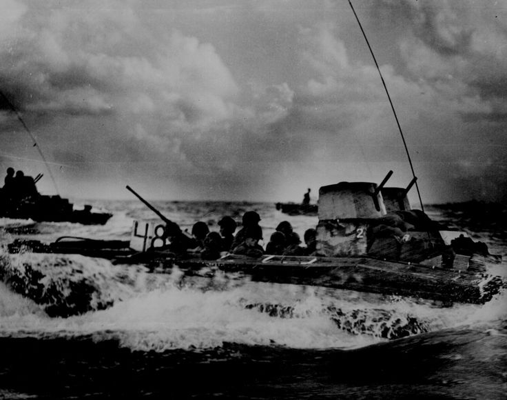 """""""A Water Buffalo, loaded with Marines, churns through the sea bound for beaches of Tinian Island near Guam."""" July 1944.(National Archives)"""