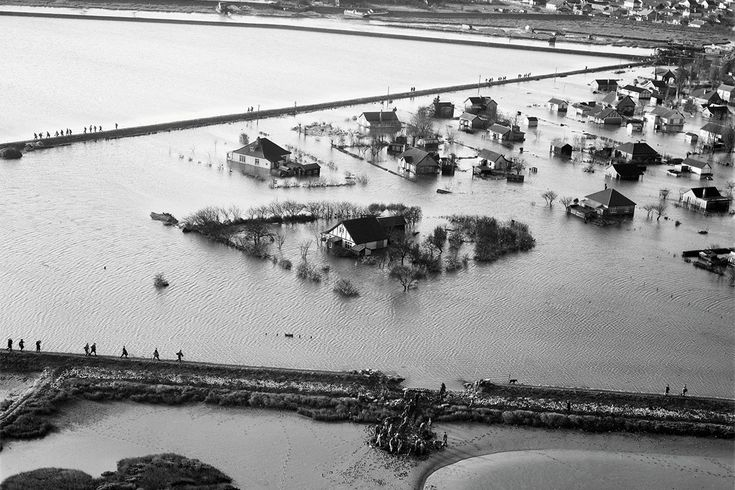 A breach in the seawall, Canvey Island, 1953. Our family took in an old couple whose home had been flooded.