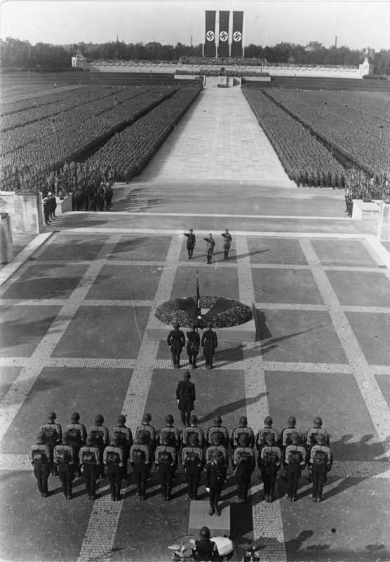 Nazi Rally, 1934 - Nuremberg, Germany. This picture shows a strict military dictatorship, the strict rules give it order and so does the military power. On the other hand the racism and discrimination makes it unbalanced and disorderly.