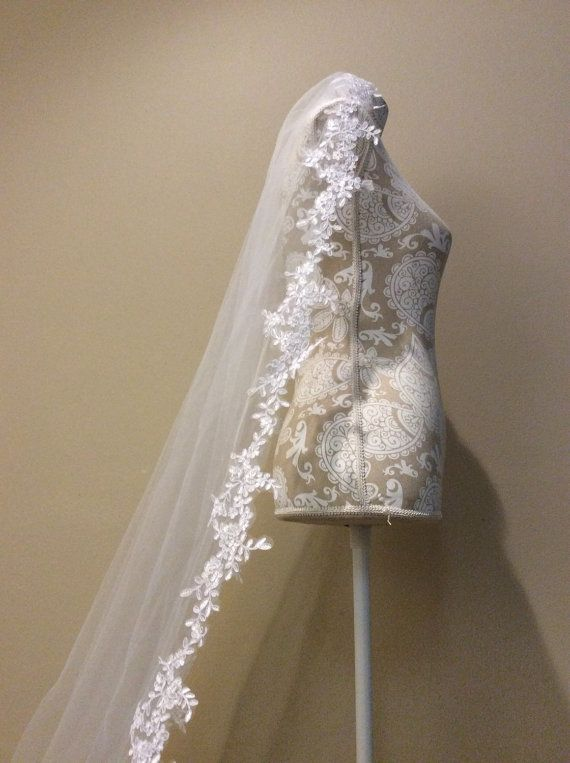 High quality beautiful long veil with lace at the by StevenBridal