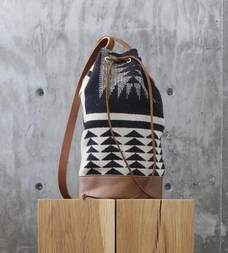 Made with authentic Pendleton wool, this hand-crafted bag is the perfect size for your everyday adventures.
