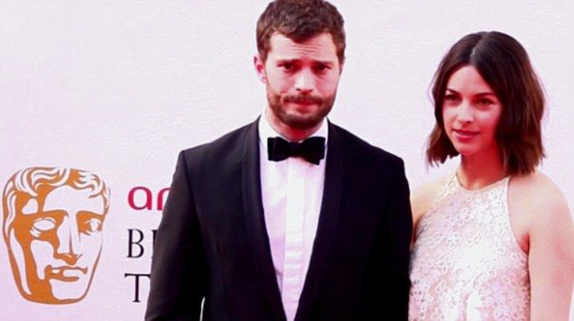 Handsome Jamie Dornan and beautiful wife Amelia Warner pose for the camera at BAFTAs.
