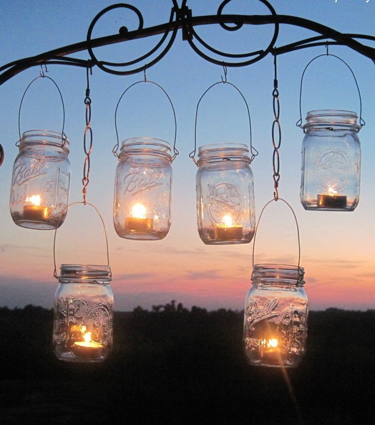 Another easy DIY outdoor mason jar/candle project. Hang from an arched garden arbor and voilà - magic.
