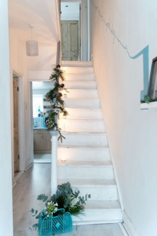 "This festively decorated staircase is from our feature ""Crafty Christmas"""