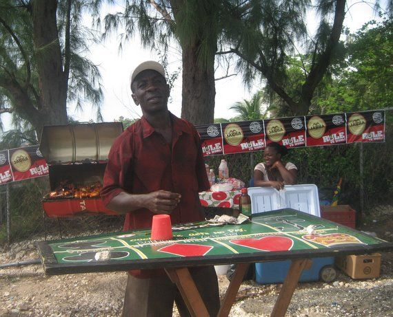 Crown and Anchor - a traditional Jamaican board game, Treasure Beach, Jamaica (pan chicken in the background)