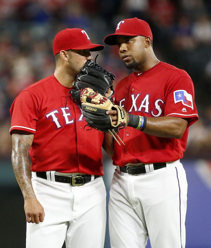 Texas Rangers relief pitcher Matt Bush (51) talks with shortstop Elvis Andrus during the 8th inning against Oakland Athletics at Globe Life Park in Arlington, Texas, Wednesday, July 27, 2016. Bush gave up four runs before being relieved by relief pitcher Jake Diekman. Texas Rangers lost 6-4. (Jae S. Lee/The Dallas Morning News)