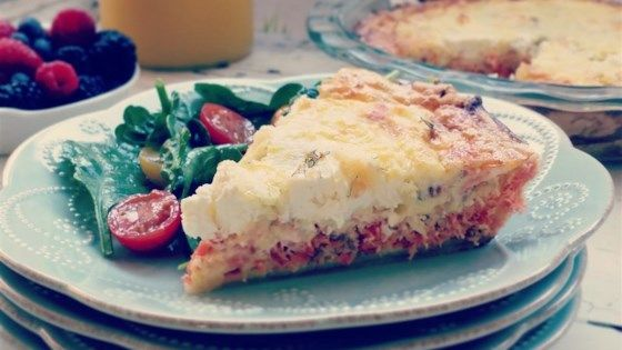 Smoked salmon quiche made with a layer of cream cheese and mozzarella cheese is a specialty brunch item for your family and friends.