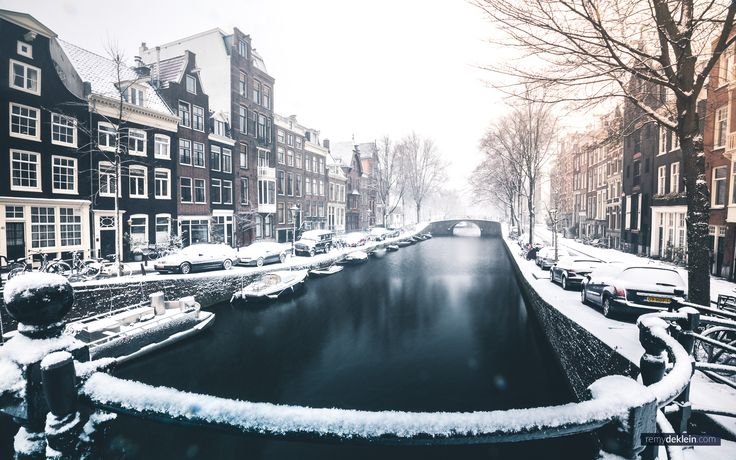 Snow covered Canals in Amsterdam [2048  1280] (OC)