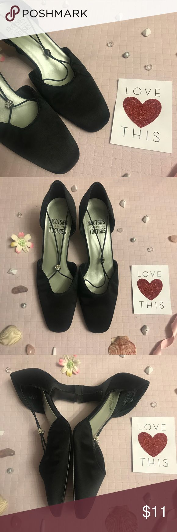 Mootsies Tootsies Size 7 Black Satin Heels Mootsies Tootsies Size 7 Black satin heels  in great condition only worn once.  Great  for a night on the town these 2 1/2 inch heels have a black elastic strap with small flowers rhinestones that adjust to fit.  Prices are always negotiable and bundling is always appreciated and discounted   #mootsiestootsies #black #blacksatin Mootsies Tootsies Shoes Heels